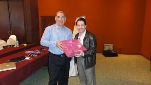 Cralos Guzman presenting gift to Francois Muscat