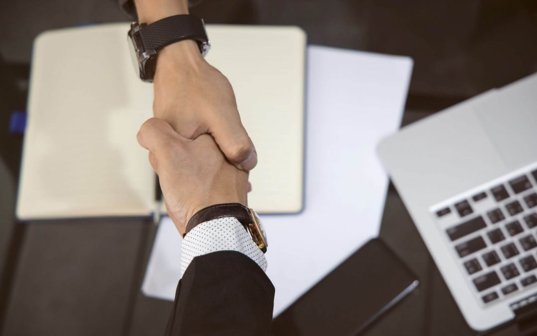Two hands joint together with a handshake